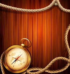 Vintage background with a compass and marine rope vector