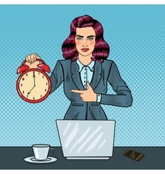Pop art business woman holding alarm clock vector