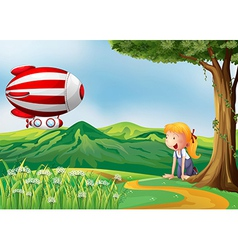 A girl looking at the red plane vector image vector image
