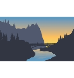 Silhouette of river and bridge vector