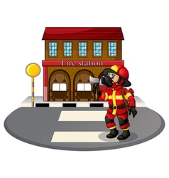A fireman in front of the fire station vector image vector image