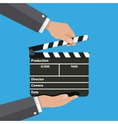 Black opened clapperboard in hands vector image