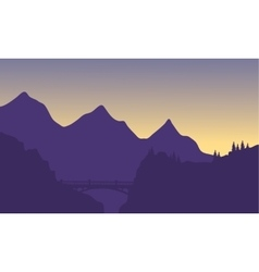 Silhouette of mountain and bridge vector