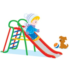 Child on a slide vector