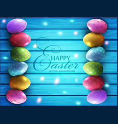Colored eggs lying on a blue wooden board vector