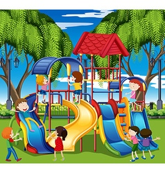 Kids play on slide at the playground vector image