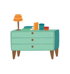 Light blue wooden chest of drawers with lamp and vector
