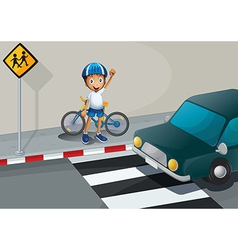 A boy with a bike standing near the pedestrian vector