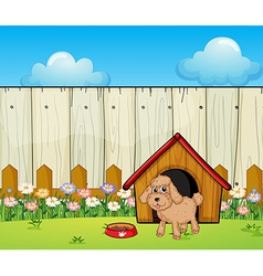 A dog with a dog house inside the fence vector