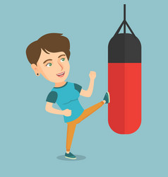 young caucasian woman exercising with punching bag vector image vector image