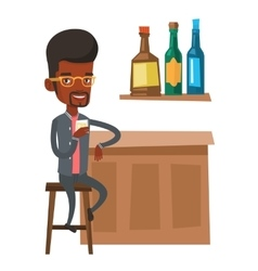 Young man sitting at the bar counter vector