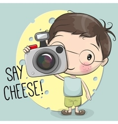 Cute cartoon boy with a camera vector