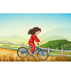 A girl biking at the farm vector
