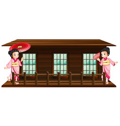 Two japanese girls at wooden hut vector