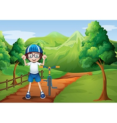 A happy child with a bike at the pathway with a vector image vector image