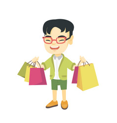 Happy asian boy holding shopping bags vector