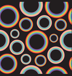 Different pastel rainbow circles on black vector