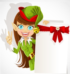 Lovely girl the christmas elf with a banner vector