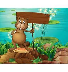 A beaver above the stump holding an empty vector