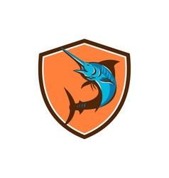 Blue marlin fish jumping shield retro vector