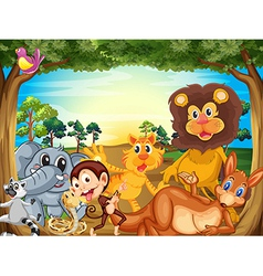 A group of animals relaxing under the tree vector