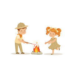 Kids in scout costumes near the bonfire boy vector