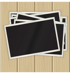 photos on a wooden surface vector image