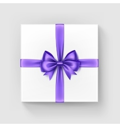 White square gift box with purple bow and ribbon vector