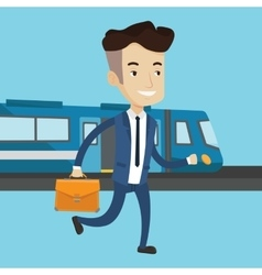 Businessman at train station vector image