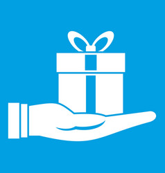 gift box in hand icon white vector image