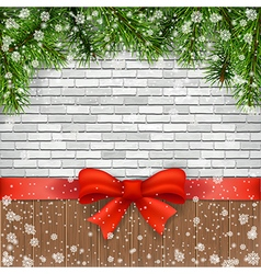 Pine branches and bow on a background of bricks vector