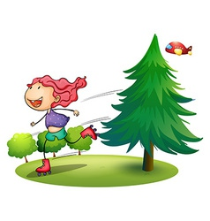 A girl rollerskating near the pine tree vector image vector image