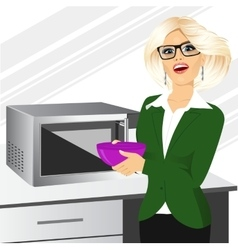 Businesswoman using microwave to heat food vector