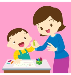 mom and boy drawing vector image