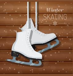 White ice skates on wooden vector