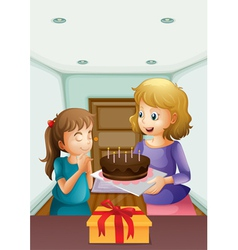 A girl wishing before blowing her birthday cake vector