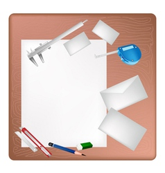 Architect tools lying on a blank page and envelope vector