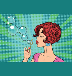 Young woman blowing bubbles vector
