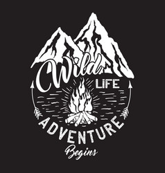 Wildlife inscription with mountains and campfire vector