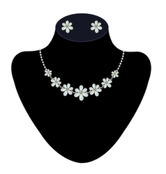 Necklace and earrings on a mannequin vector