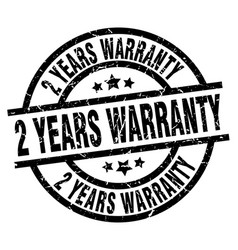 2 years warranty round grunge black stamp vector