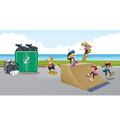 Kids playing skateboard on the ramp vector