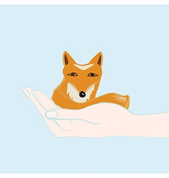 Little fox cupped in a hand vector