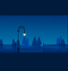 silhouette of garden with fence and street lamp vector image vector image