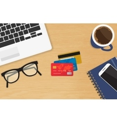 Realistic workplace with three credit cards vector
