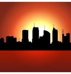 Sunset over City Skyscrappers Silhouette vector image