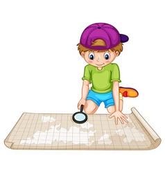 Boy looking at the atlas vector image vector image