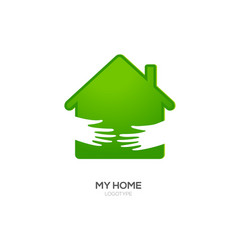 Two hands hold green house vector