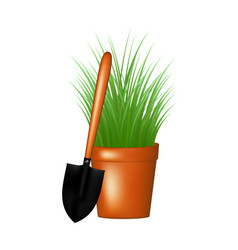Garden trowel and grass in flowerpot vector