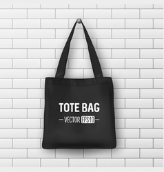 Realistic black textile tote bag closeup vector